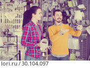 Couple consider the purchase of a new bedside lamp. Стоковое фото, фотограф Яков Филимонов / Фотобанк Лори