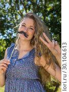 Купить «Pretty blonde with fake mustache», фото № 30104613, снято 19 ноября 2014 г. (c) Wavebreak Media / Фотобанк Лори