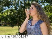 Купить «Pretty blonde using her inhaler», фото № 30104617, снято 19 ноября 2014 г. (c) Wavebreak Media / Фотобанк Лори