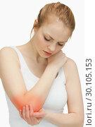 Woman touching her painful elbow. Стоковое фото, агентство Wavebreak Media / Фотобанк Лори