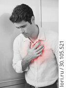 Купить «Casual young man with chest pain», фото № 30105521, снято 2 августа 2013 г. (c) Wavebreak Media / Фотобанк Лори