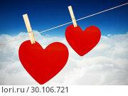 Купить «Composite image of hearts hanging on a line», фото № 30106721, снято 19 января 2015 г. (c) Wavebreak Media / Фотобанк Лори
