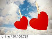 Купить «Composite image of hearts hanging on a line», фото № 30106729, снято 19 января 2015 г. (c) Wavebreak Media / Фотобанк Лори