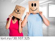 Купить «Composite image of young couple with bags over heads», фото № 30107325, снято 19 января 2015 г. (c) Wavebreak Media / Фотобанк Лори
