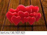 Купить «Composite image of love hearts», фото № 30107921, снято 21 января 2015 г. (c) Wavebreak Media / Фотобанк Лори