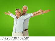 Купить «Composite image of happy couple standing with arms outstretched», фото № 30108581, снято 21 января 2015 г. (c) Wavebreak Media / Фотобанк Лори