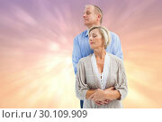 Composite image of happy mature couple embracing with eyes closed. Стоковое фото, агентство Wavebreak Media / Фотобанк Лори