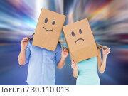Купить «Composite image of couple wearing sad face boxes on their heads», фото № 30110013, снято 21 января 2015 г. (c) Wavebreak Media / Фотобанк Лори