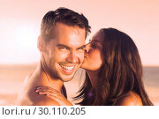 Купить «Attractive woman kissing her boyfriend on the cheek», фото № 30110205, снято 4 апреля 2013 г. (c) Wavebreak Media / Фотобанк Лори