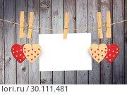Купить «Composite image of hearts hanging on the line», фото № 30111481, снято 23 января 2015 г. (c) Wavebreak Media / Фотобанк Лори
