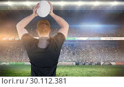 Купить «Composite image of rugby player about to throw a rugby ball», фото № 30112381, снято 17 сентября 2015 г. (c) Wavebreak Media / Фотобанк Лори