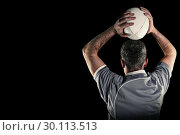 Composite image of rugby player about to throw a rugby ball. Стоковое фото, агентство Wavebreak Media / Фотобанк Лори