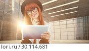 Купить «Composite image of smiling hipster woman using her tablet», фото № 30114681, снято 5 февраля 2016 г. (c) Wavebreak Media / Фотобанк Лори