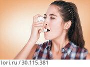 Купить «Composite image of woman having asthma using the asthma inhaler», фото № 30115381, снято 27 апреля 2016 г. (c) Wavebreak Media / Фотобанк Лори