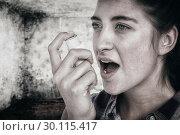 Купить «Composite image of woman having asthma using the asthma inhaler», фото № 30115417, снято 27 апреля 2016 г. (c) Wavebreak Media / Фотобанк Лори