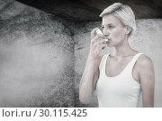 Купить «Composite image of blonde woman taking her inhaler», фото № 30115425, снято 27 апреля 2016 г. (c) Wavebreak Media / Фотобанк Лори