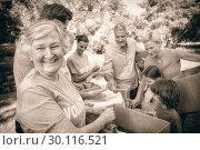 Купить «Happy volunteer family separating donations stuffs», фото № 30116521, снято 16 августа 2016 г. (c) Wavebreak Media / Фотобанк Лори
