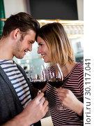 Купить «Happy young couple holding wineglass », фото № 30117041, снято 6 апреля 2016 г. (c) Wavebreak Media / Фотобанк Лори