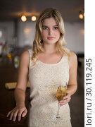 Portrait of beautiful woman holding a champagne flute. Стоковое фото, агентство Wavebreak Media / Фотобанк Лори