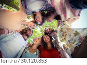 Купить «Happy friends forming a huddle in park», фото № 30120853, снято 20 июля 2016 г. (c) Wavebreak Media / Фотобанк Лори