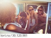 Купить «Woman taking photograph of friends in campervan», фото № 30120981, снято 20 июля 2016 г. (c) Wavebreak Media / Фотобанк Лори