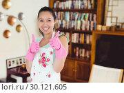 Купить «Composite image of woman wearing rubber gloves giving thumbs up», фото № 30121605, снято 15 сентября 2016 г. (c) Wavebreak Media / Фотобанк Лори
