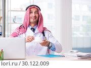 Купить «Arab doctor working in the clinic», фото № 30122009, снято 21 ноября 2018 г. (c) Elnur / Фотобанк Лори