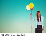 Купить «Smiling woman holding balloon against blue background», фото № 30122529, снято 23 ноября 2016 г. (c) Wavebreak Media / Фотобанк Лори