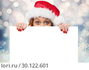 Купить «Woman showing whitecard against blurry background», фото № 30122601, снято 23 ноября 2016 г. (c) Wavebreak Media / Фотобанк Лори