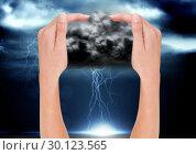 Купить «digital composite of hands catching bad wheather», фото № 30123565, снято 23 ноября 2016 г. (c) Wavebreak Media / Фотобанк Лори
