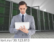 Купить «Businessman using digital tablet against database server systems in background», фото № 30123813, снято 1 декабря 2016 г. (c) Wavebreak Media / Фотобанк Лори