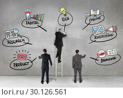 Business professionals drawing business planning concepts against grey background. Стоковое фото, агентство Wavebreak Media / Фотобанк Лори