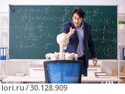 Купить «Young male math teacher and student skeleton», фото № 30128909, снято 19 октября 2018 г. (c) Elnur / Фотобанк Лори