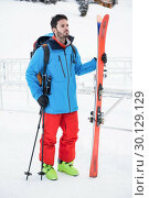 Купить «Skier standing on snow covered mountains», фото № 30129129, снято 18 ноября 2016 г. (c) Wavebreak Media / Фотобанк Лори