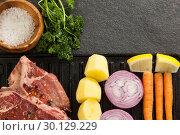 Купить «Sirloin chop and ingredients on black grill», фото № 30129229, снято 20 сентября 2016 г. (c) Wavebreak Media / Фотобанк Лори