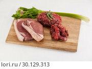 Купить «Sirloin chop, beef patty and diced beef on wooden board», фото № 30129313, снято 20 сентября 2016 г. (c) Wavebreak Media / Фотобанк Лори
