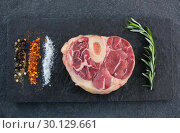 Купить «Sirloin chop, rosemary herb an spices on slate plate», фото № 30129661, снято 20 сентября 2016 г. (c) Wavebreak Media / Фотобанк Лори