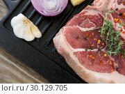 Купить «Sirloin chop and ingredients on grill tray», фото № 30129705, снято 20 сентября 2016 г. (c) Wavebreak Media / Фотобанк Лори