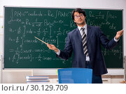 Купить «Young male math teacher in classroom», фото № 30129709, снято 11 октября 2018 г. (c) Elnur / Фотобанк Лори