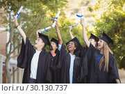 Купить «Smiling graduate school kids standing with degree scroll in campus», фото № 30130737, снято 19 ноября 2016 г. (c) Wavebreak Media / Фотобанк Лори