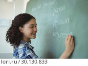 Купить «Schoolgirl pretending to be a teacher in classroom», фото № 30130833, снято 20 ноября 2016 г. (c) Wavebreak Media / Фотобанк Лори