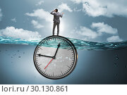 Купить «Businessman in deadline and time management concept», фото № 30130861, снято 19 марта 2019 г. (c) Elnur / Фотобанк Лори