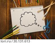 Купить «Thought bubble drawn on notebook placed with coloring tools », фото № 30131613, снято 25 января 2017 г. (c) Wavebreak Media / Фотобанк Лори