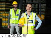 Купить «Portrait of factory workers standing in drinks production factory», фото № 30132981, снято 20 октября 2016 г. (c) Wavebreak Media / Фотобанк Лори