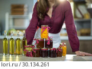 Купить «Olive oil, jam, pickle placed together on table», фото № 30134261, снято 4 октября 2016 г. (c) Wavebreak Media / Фотобанк Лори
