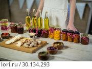 Купить «Olive oil, jam, pickle placed together on table», фото № 30134293, снято 4 октября 2016 г. (c) Wavebreak Media / Фотобанк Лори