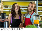 Купить «Smiling shop assistants standing together in health grocery shop», фото № 30134409, снято 4 октября 2016 г. (c) Wavebreak Media / Фотобанк Лори