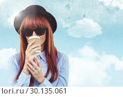 Купить «Woman with coffee against sky with flare background», фото № 30135061, снято 6 февраля 2017 г. (c) Wavebreak Media / Фотобанк Лори