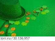 Купить «St. Patricks Day leprechaun hat, chocolate gold coins, beads and shamrocks», фото № 30136957, снято 11 января 2017 г. (c) Wavebreak Media / Фотобанк Лори