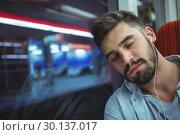 Купить «Executive sleeping while listening music», фото № 30137017, снято 13 сентября 2016 г. (c) Wavebreak Media / Фотобанк Лори